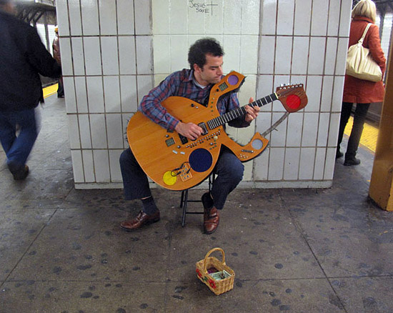 Busking with the Guitar2D2 - an instrument with a built-in drum machine, keyboard, effects and amps. 5 speakers and 29 lbs.